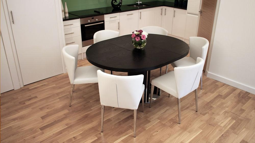 Black Ash Round Extending Dining Table | Pedestal Base | Uk With Regard To Most Recently Released Extending Dining Sets (Image 4 of 20)