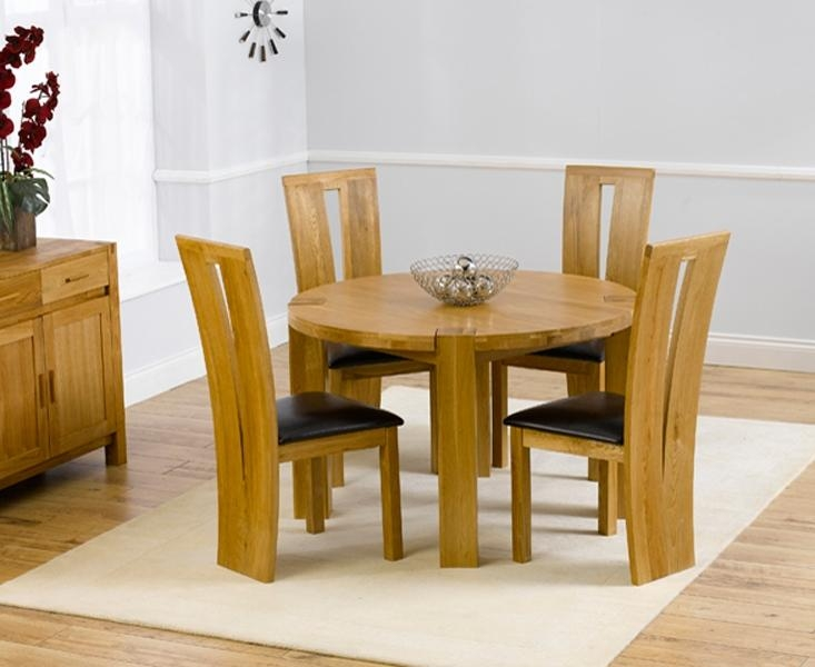 Bromham Round Oak Dining Table And 4 Black Chairs – Starrkingschool In Most Current Round Oak Dining Tables And Chairs (View 13 of 20)