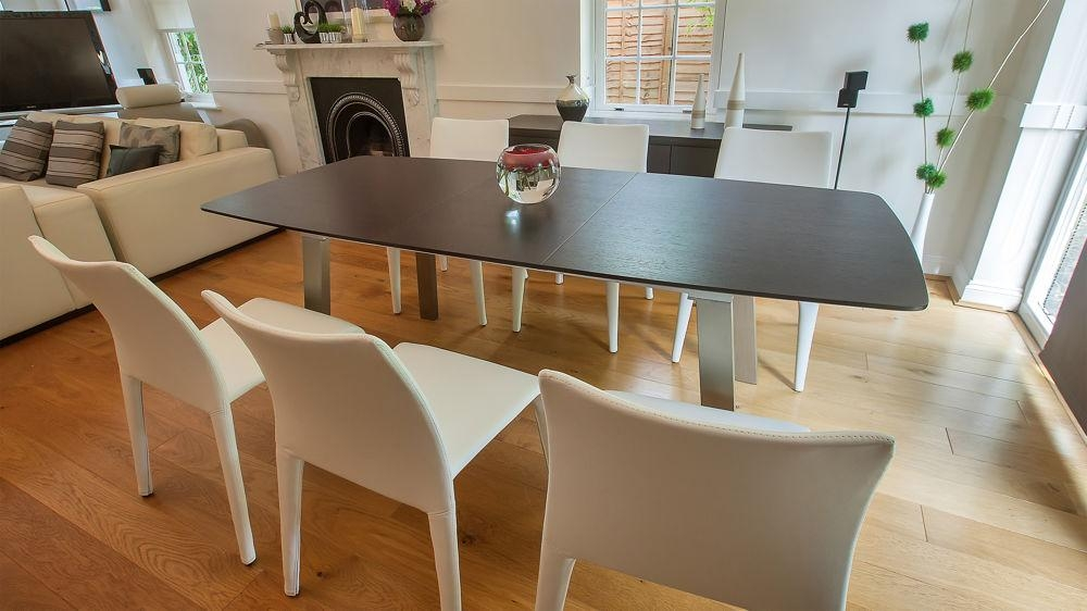 Extending Dark Wood 8 Seater Dining Table | Brushed Metal Regarding Most Popular Dark Wood Extending Dining Tables (Image 14 of 20)