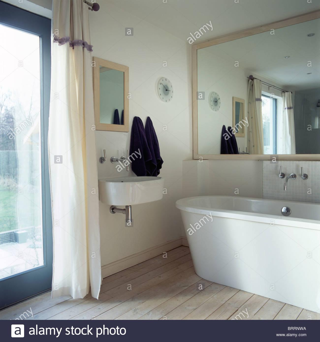 Large Mirror Above Modern Bath In Small Modern Bathroom With Stock With Large Mirrors For Bathroom Walls (Image 17 of 20)
