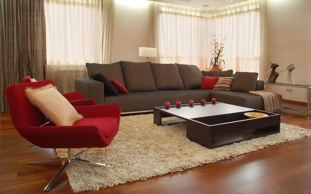 Brown Sofa And Red Chairs In A Modern Living Room Interior Design Throughout Brown Sofa Chairs (Image 3 of 10)