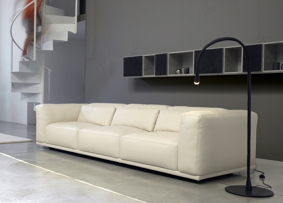 Long Black Floating Shelves Above Modern White Leathered Sofa Set For Long Modern Sofas (View 7 of 10)