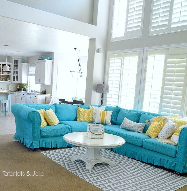 Switching Things Up For Summer With A Turquoise Slipcover Within Turquoise Sofas (Image 7 of 10)