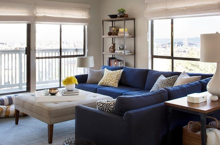 Blue Sectional With Light Gray Tufted Ottoman As Coffee Table Pertaining To Mill Large Leather Coffee Tables (View 38 of 40)