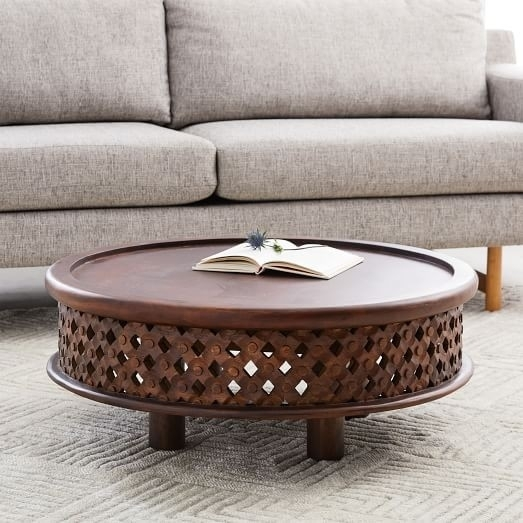 Carved Wood Coffee Tables Round Tribal Table World Market 1280×720 With Round Carved Wood Coffee Tables (Image 16 of 40)