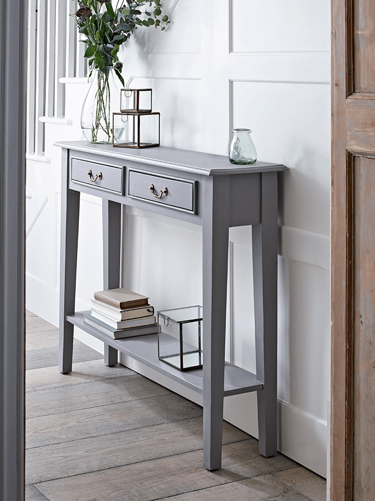 With A Warm Grey Painted Finish And Two Slender Drawers With Simple For Round White Wash Brass Painted Coffee Tables (View 30 of 40)