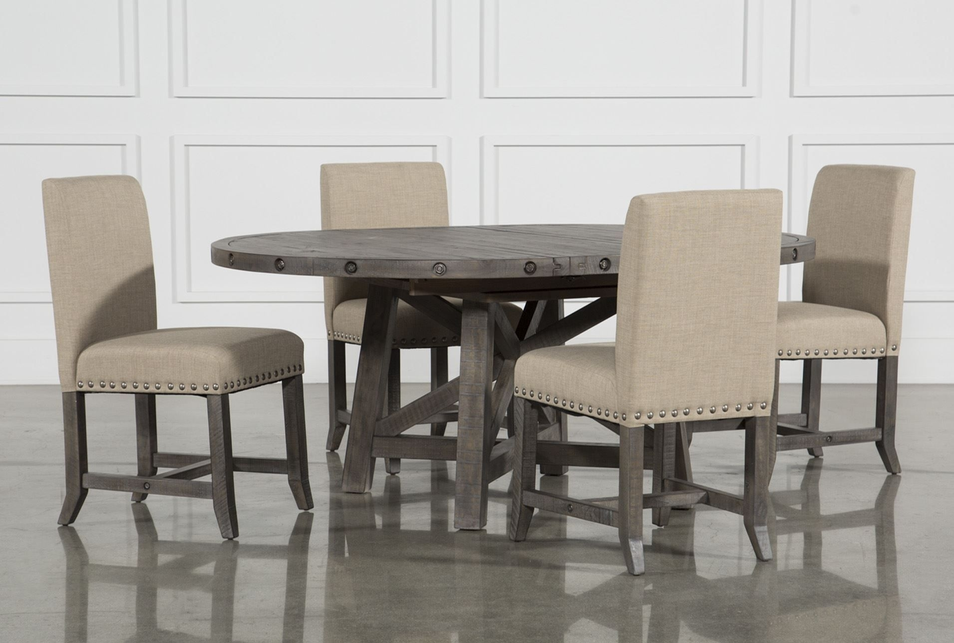 Jaxon Grey 5 Piece Round Extension Dining Set W/upholstered Chairs In Most Up To Date Chandler 7 Piece Extension Dining Sets With Fabric Side Chairs (View 7 of 20)