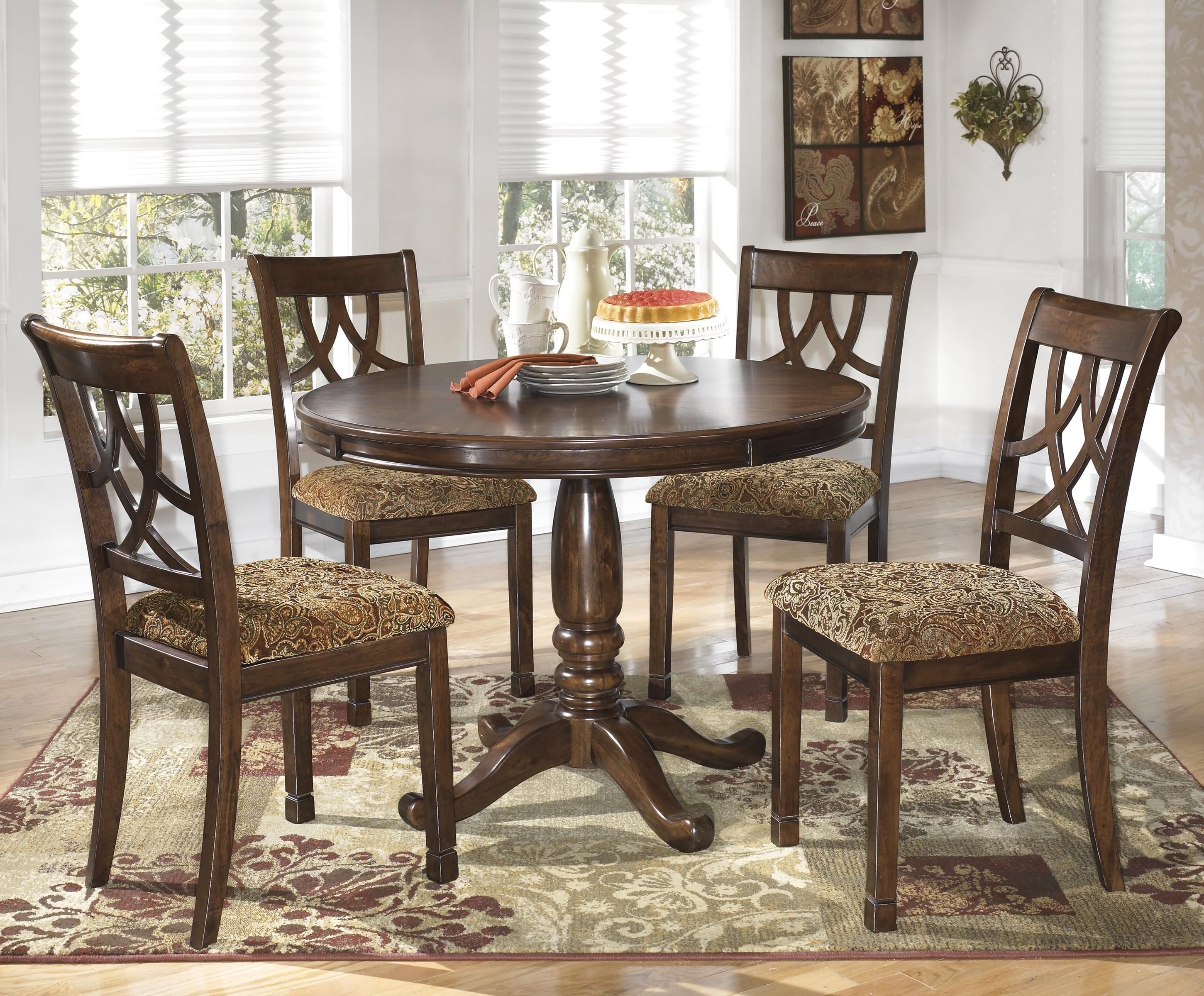 Leahlyn 5 Piece Cherry Finish Round Dining Table Setsignature Inside Most Up To Date Combs 48 Inch Extension Dining Tables (Photo 19 of 20)