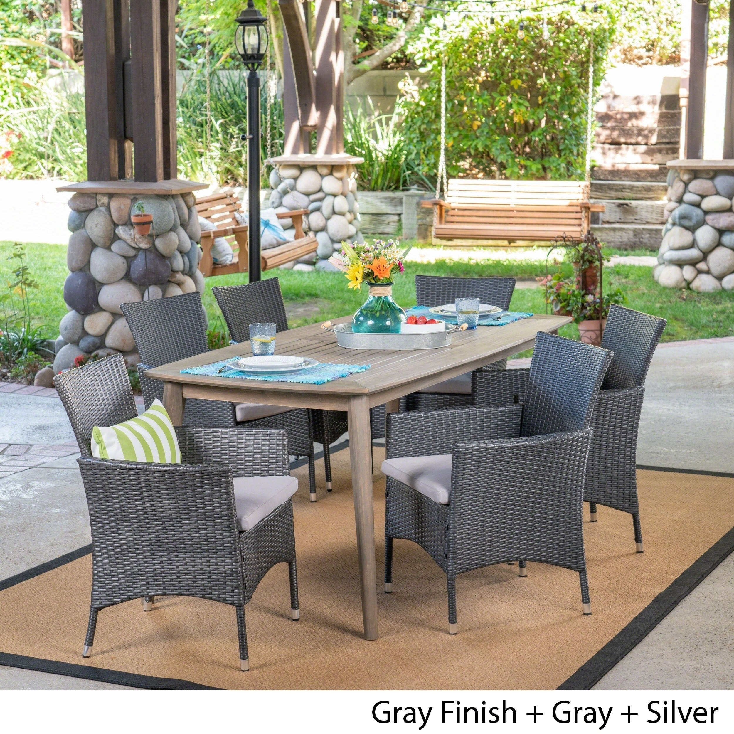 Shop Jaxon Outdoor 7 Piece Multibrown Pe Wicker Dining Set With Throughout Best And Newest Jaxon Grey 5 Piece Round Extension Dining Sets With Upholstered Chairs (View 12 of 20)