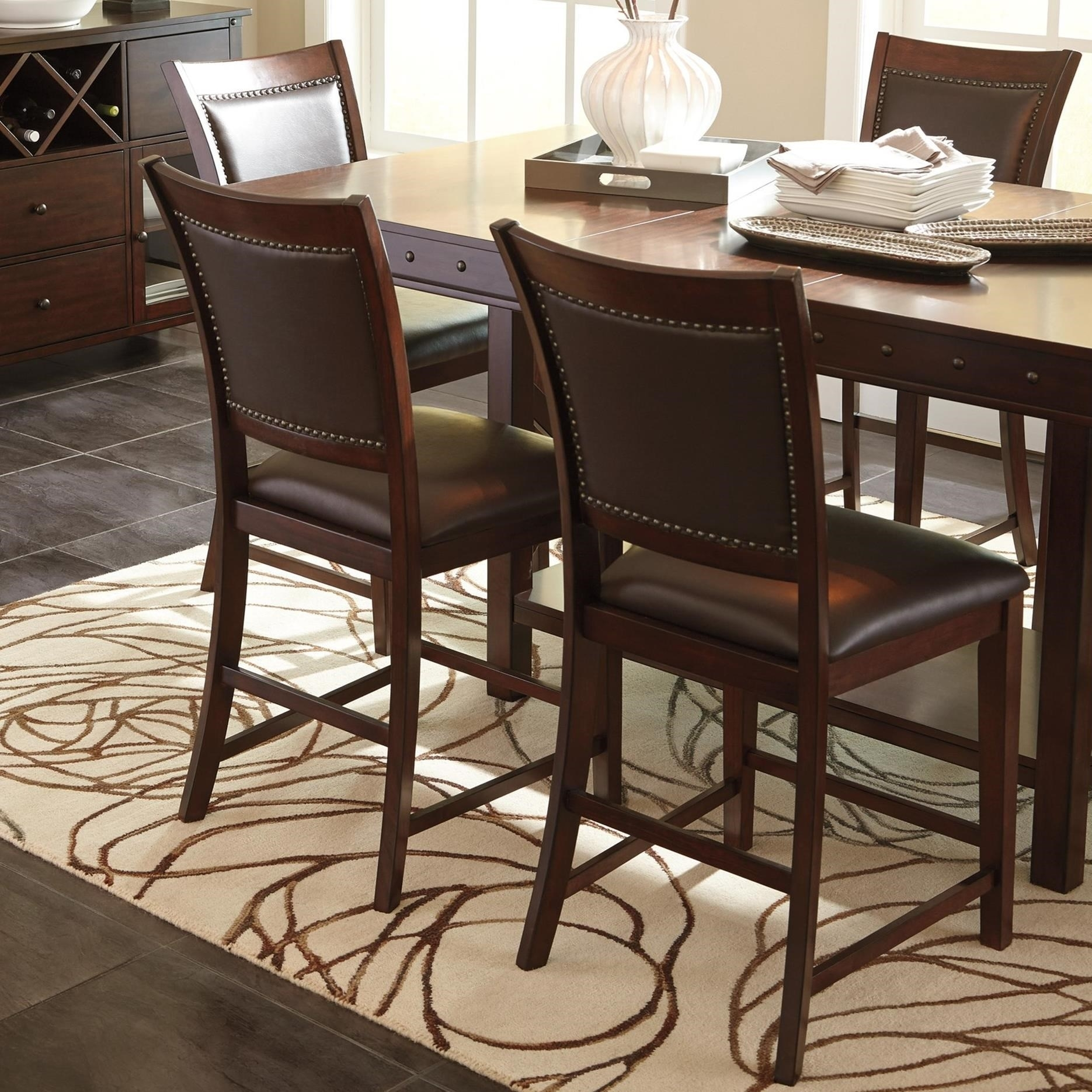 Signature Designashley Collenburg 5 Piece Counter Table Set Within Current Jaxon 5 Piece Extension Counter Sets With Fabric Stools (Image 18 of 20)