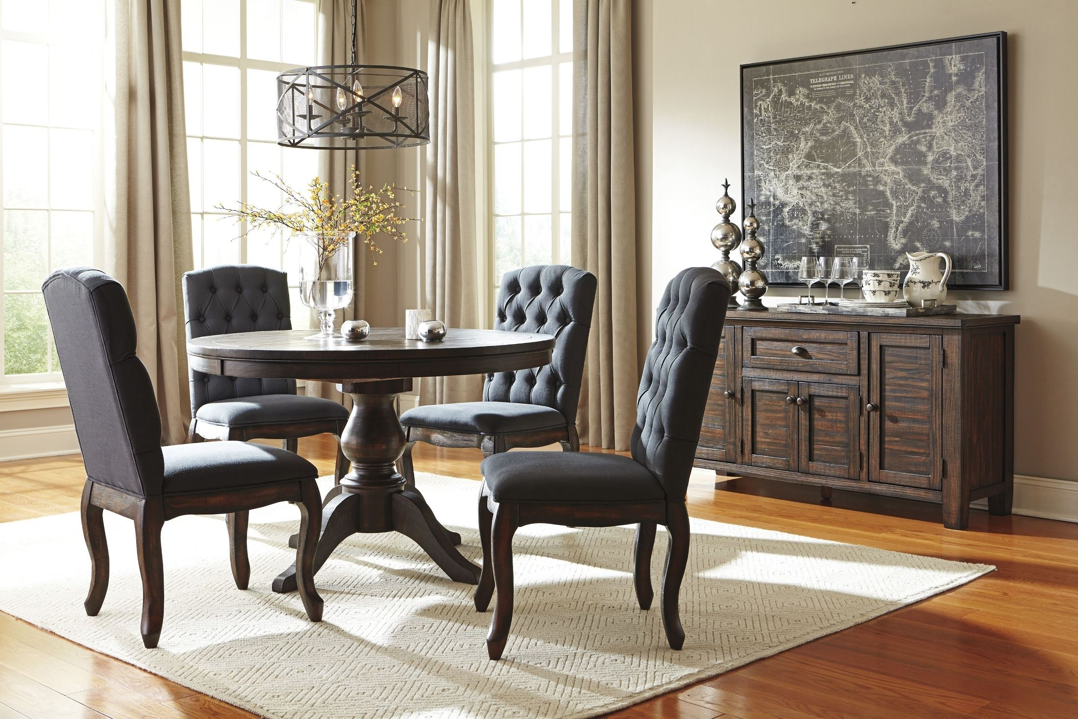 Signature Designashley Trudell Dark Brown Round Extendable For Most Recently Released Craftsman 9 Piece Extension Dining Sets With Uph Side Chairs (Image 17 of 20)