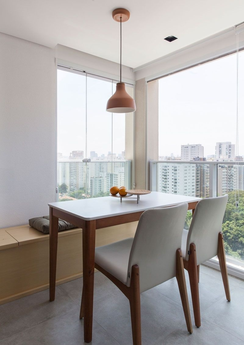 This Small Apartment In Brazil Has A Bedroom Hidden Behind A Sliding Within Most Recently Released Norwood 9 Piece Rectangle Extension Dining Sets (Image 18 of 20)