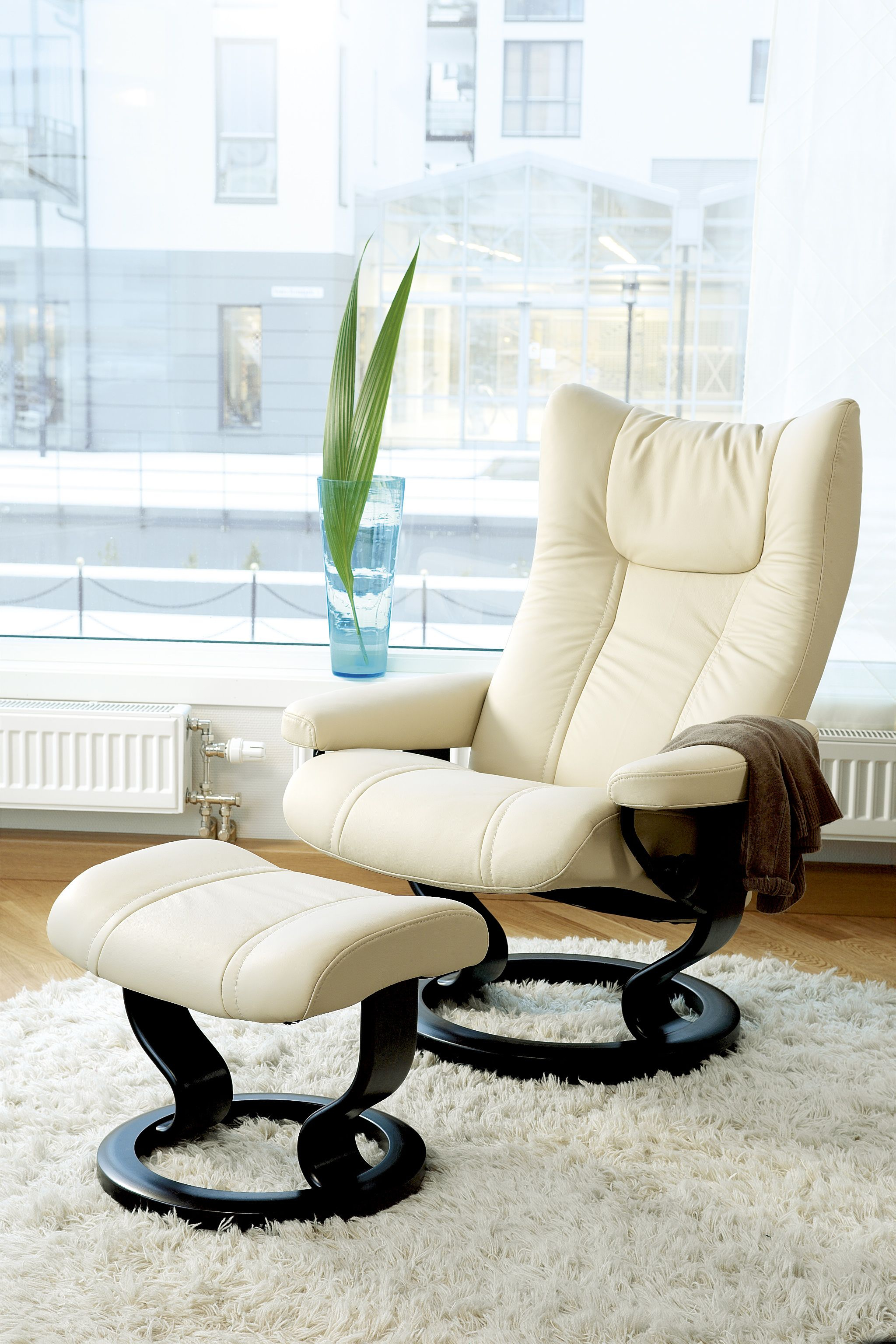 A Stylish Cream Recliner And Ottoman Perfect For The Modern Pertaining To Katrina Beige Swivel Glider Chairs (Image 1 of 20)