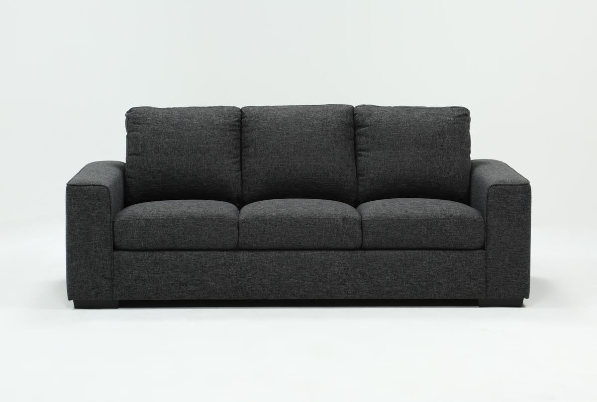 Lucy Dark Grey Sofa | Living Spaces Throughout Lucy Grey Sofa Chairs (Image 4 of 20)