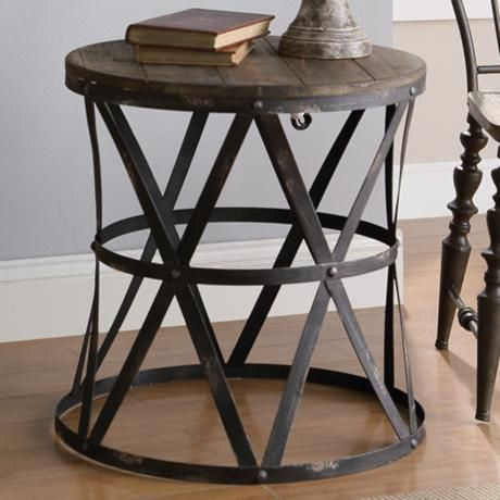 Casual Wood Top Round Accent Table Features An Industrial Within Carbon Loft Fischer Brown Solid Birch And Iron Rustic Coffee Tables (View 17 of 25)