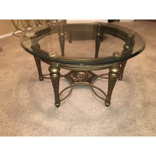 Gracewood Hollow Fanon Round Cocktail Table With Glass Top In Gracewood Hollow Fishta Antique Brass Metal Glass 3 Piece Tables (View 10 of 25)