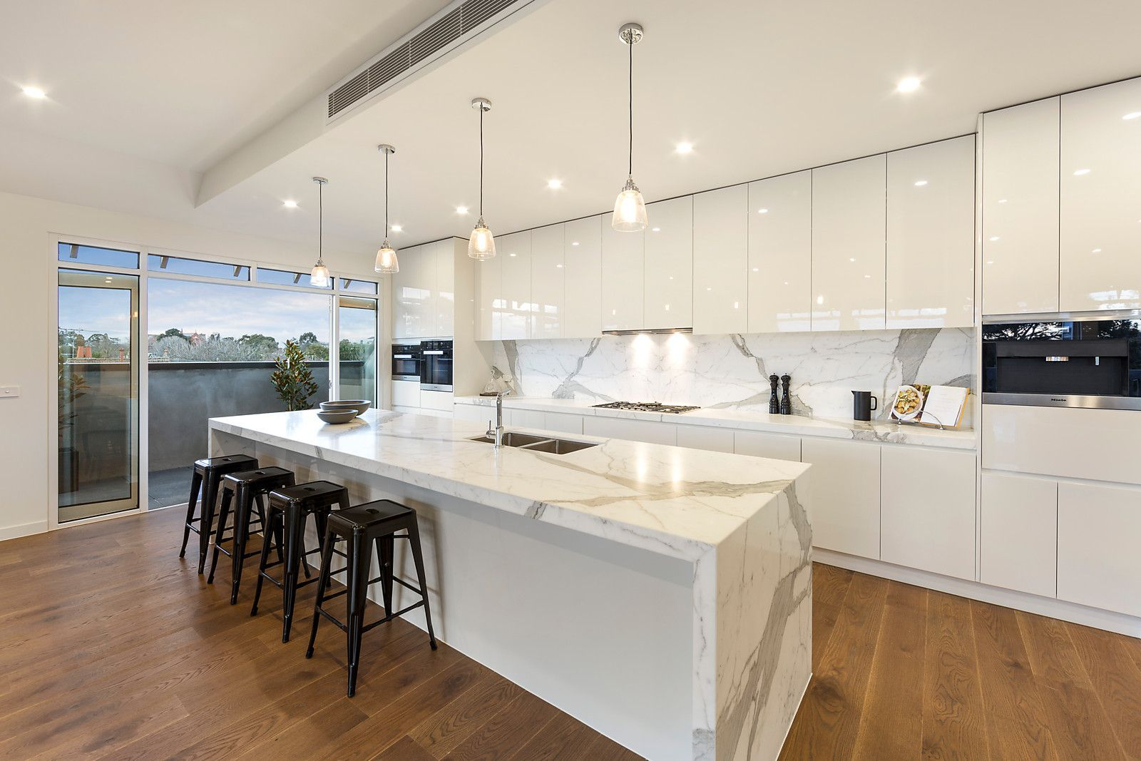 Modern White Marble Kitchen With Gloss Cabinetry And Pendant Intended For Most Popular Upland Marble Kitchen Islands (Image 18 of 25)