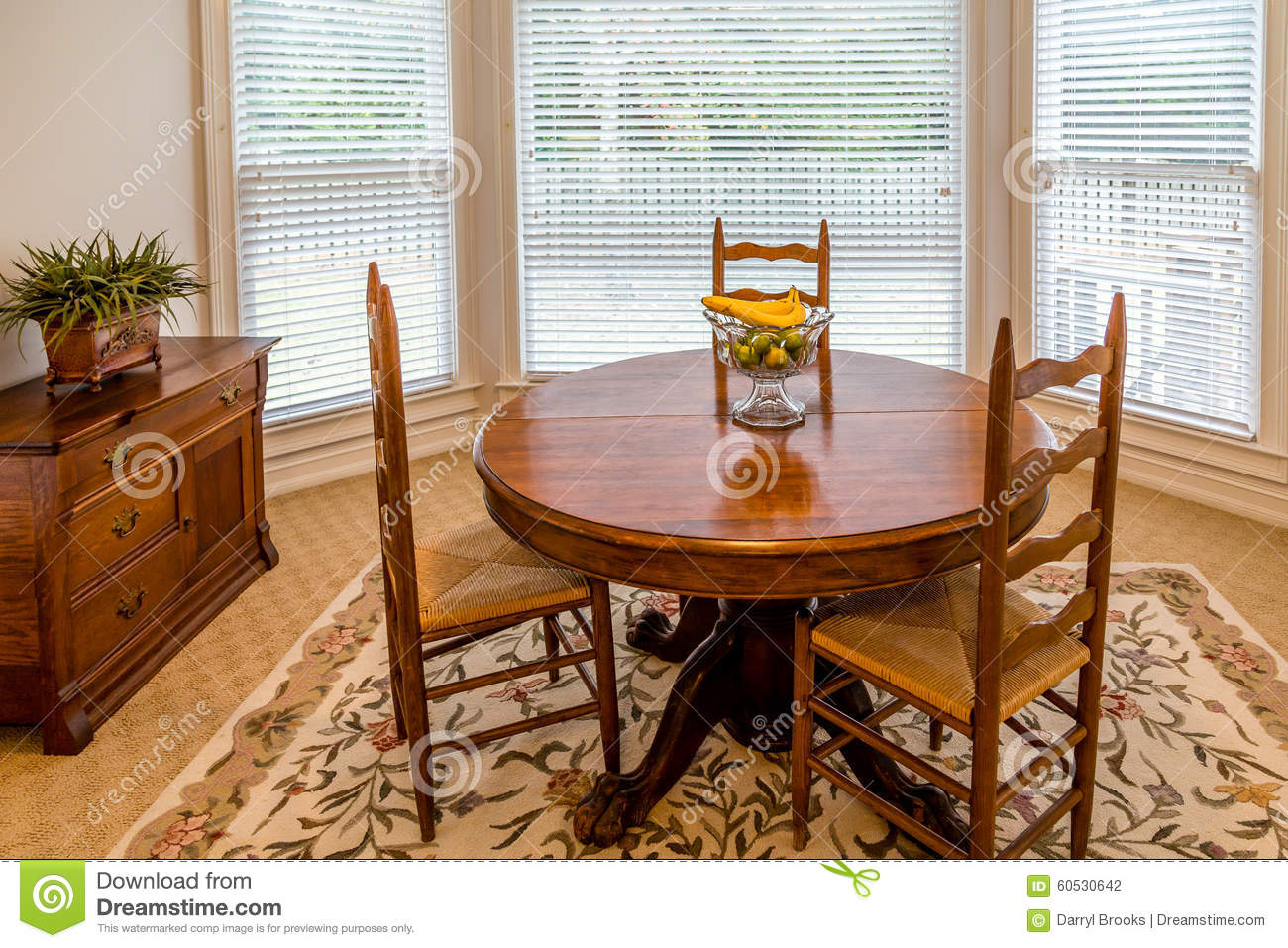 Round Dining Table In A Sunny Room Stock Photo – Image Of With 2017 Brooks Round Dining Tables (View 14 of 25)