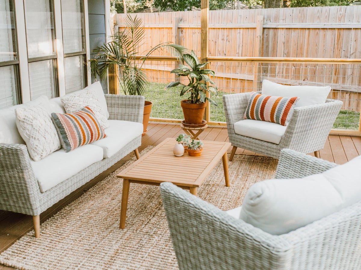 10 Designer Patio Ideas To Copy Right Now | Overstock Pertaining To Outdoor Wicker Plastic Half Moon Leaf Shape Porch Swings (View 9 of 25)