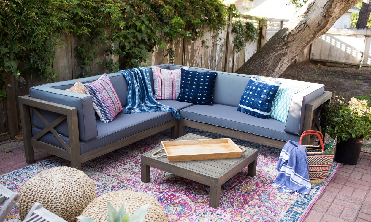 10 Designer Patio Ideas To Copy Right Now | Overstock Regarding Outdoor Wicker Plastic Half Moon Leaf Shape Porch Swings (View 13 of 25)
