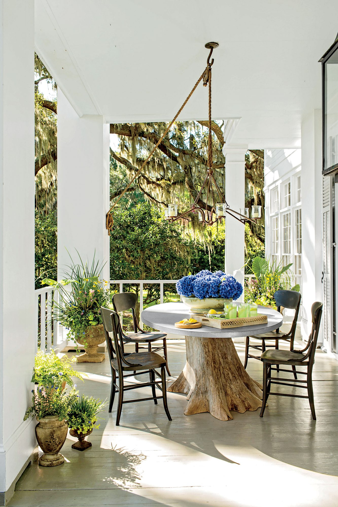 80 Breezy Porches And Patios With Regard To Outdoor Wicker Plastic Half Moon Leaf Shape Porch Swings (View 7 of 25)