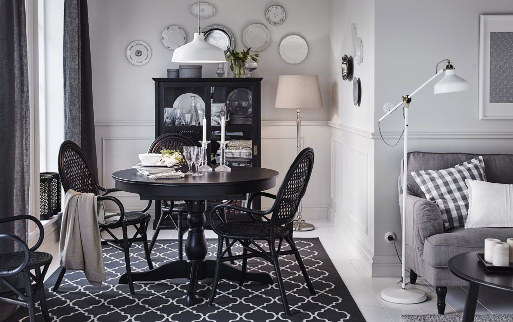 A Medium Size Dining Room With A Black Round Dining Table For Medium Elegant Dining Tables (View 15 of 25)