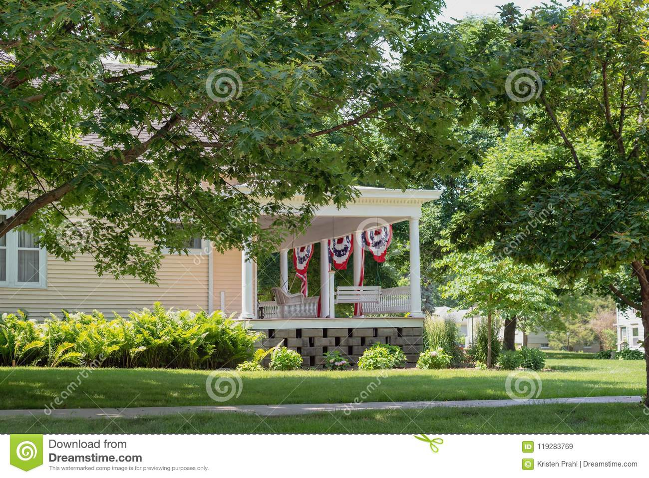Charming Front Porch Decorated With American Flags For With American Flag Porch Swings (View 11 of 25)