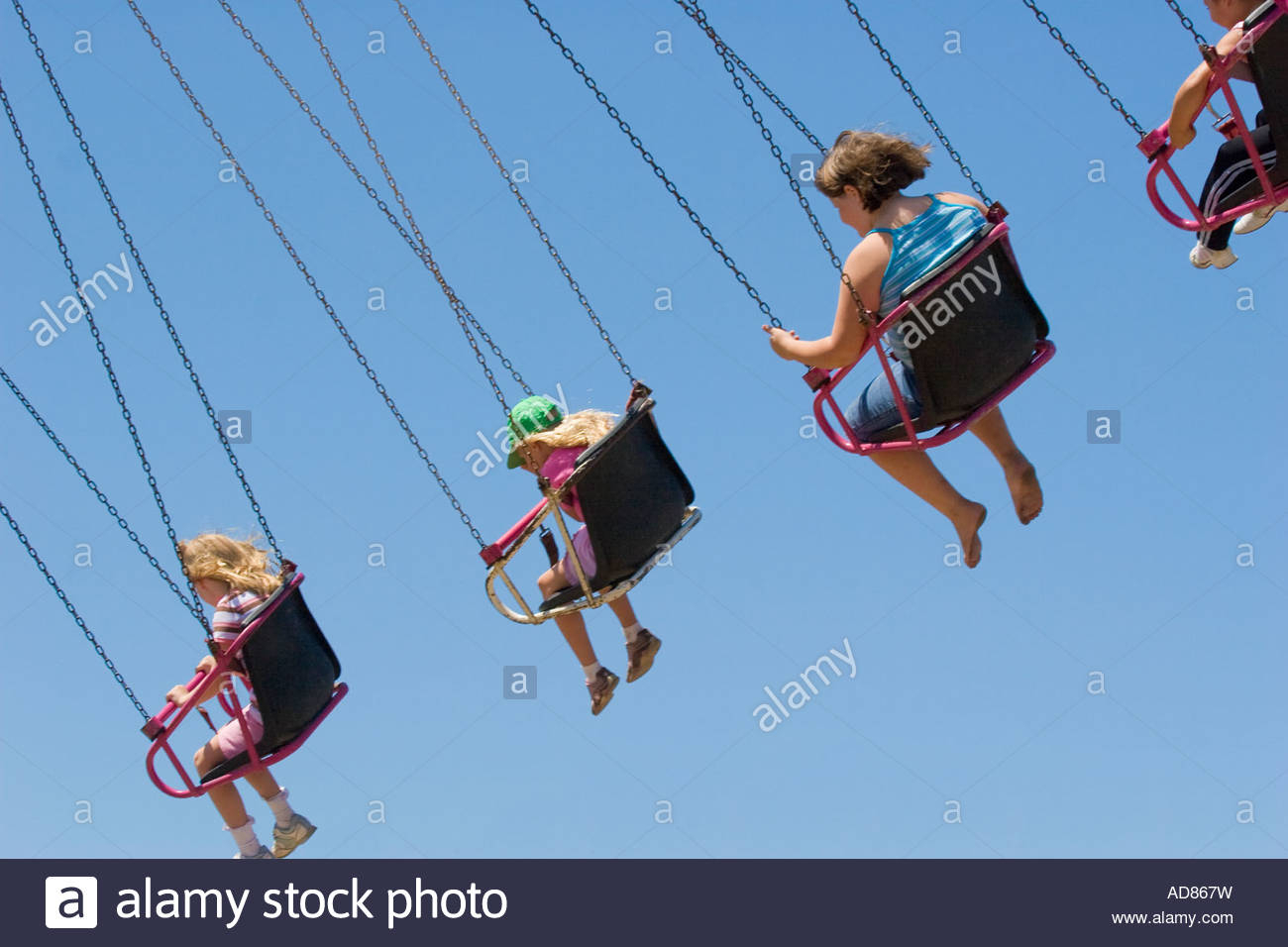 Children Flying In The Air On Seats Hanging From Chains On A Pertaining To Swing Seats With Chains (View 21 of 25)