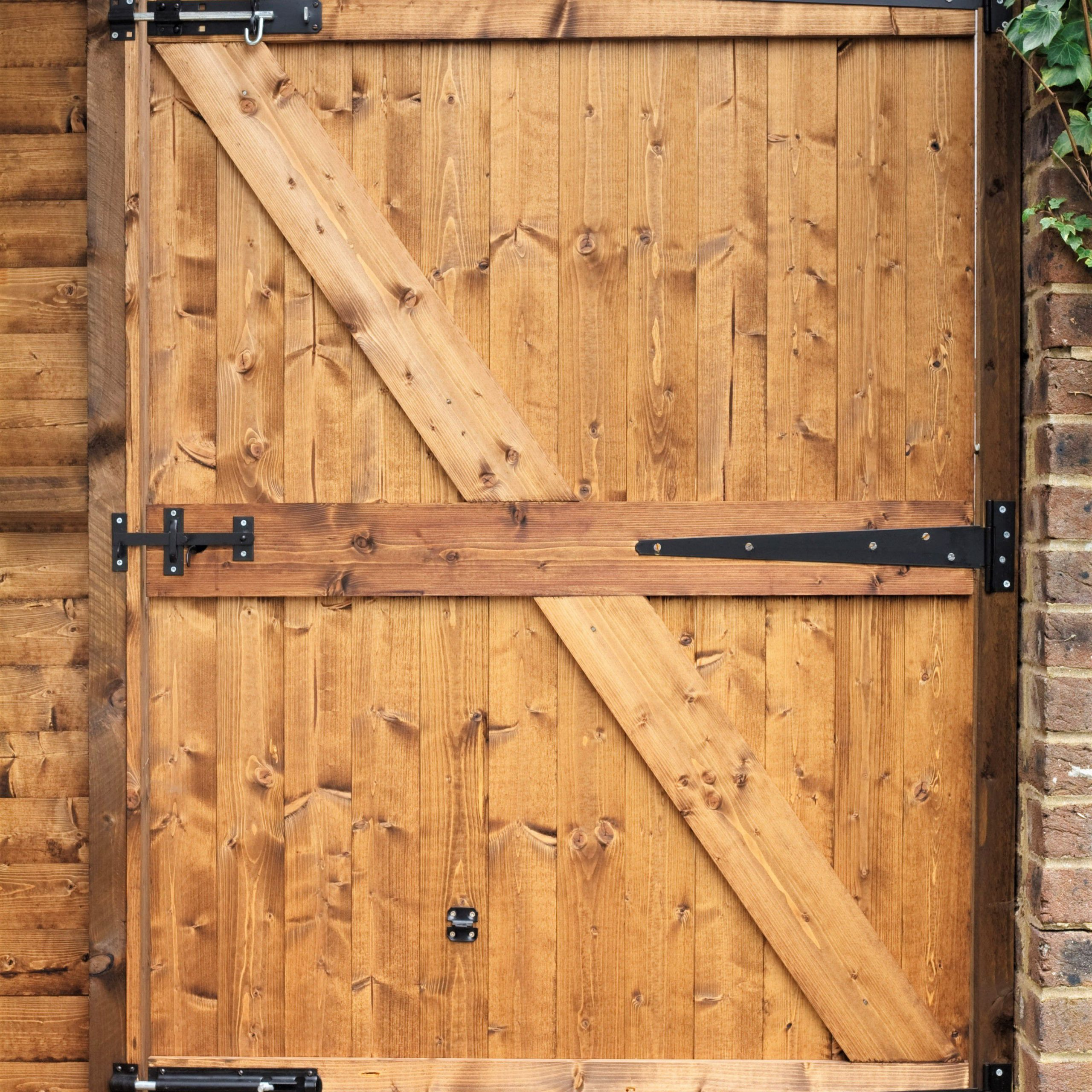 How To Build A Wooden Gate For Your Yard Pertaining To A4 Ft Cedar Pergola Swings (Image 16 of 25)