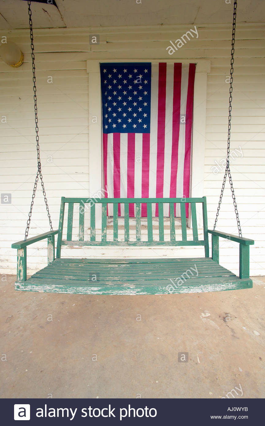 Old Swing On Porch Displaying An American Flag And Patriotic With American Flag Porch Swings (View 4 of 25)