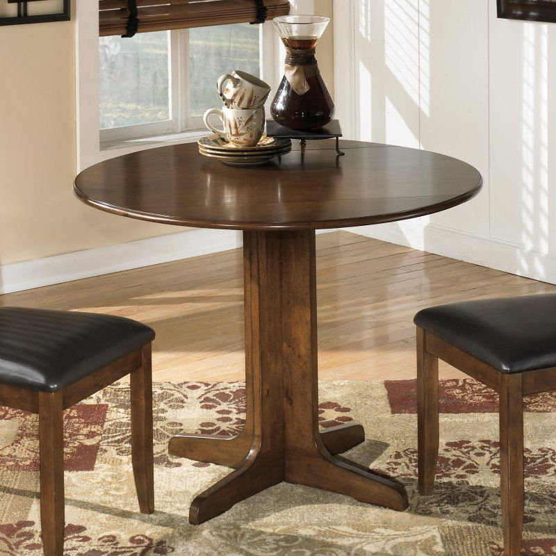 Signature Designashley Stuman Round Dining Table For Alamo Transitional 4 Seating Double Drop Leaf Round Casual Dining Tables (View 6 of 25)