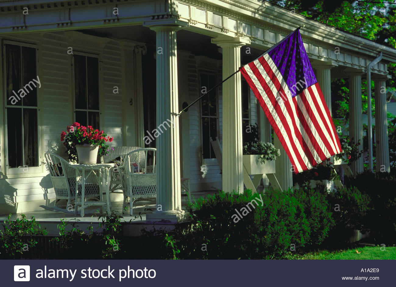 Traditional Front Porch Of A House With An American Flag In American Flag Porch Swings (View 14 of 25)