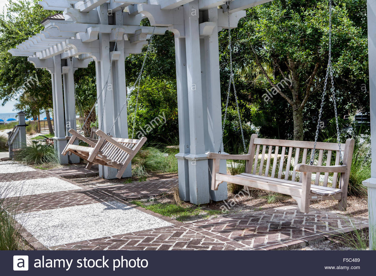 Wood Porch Swings In Park Stock Photo: 89391913 – Alamy Regarding Porch Swings (View 11 of 25)