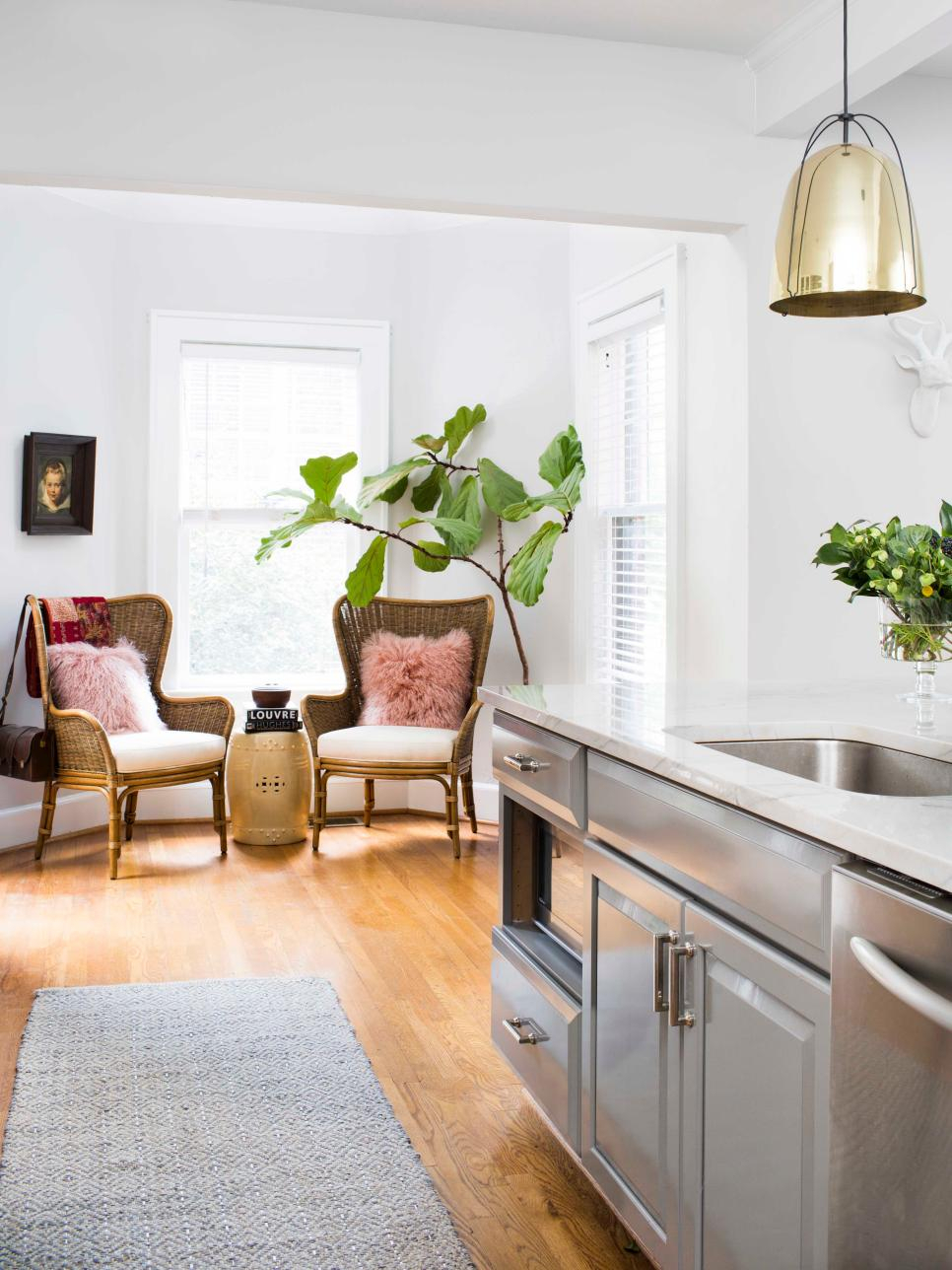 Sitting Area With Wicker Chairs And Pink Faux Fur Pillows | Hgtv For Engelhardt Ceramic Garden Stools (View 15 of 25)