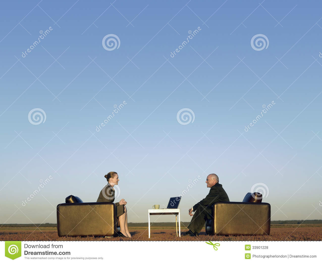 Business People On Armchairs Communicating On Field Stock Inside Popel Armchairs (View 11 of 15)