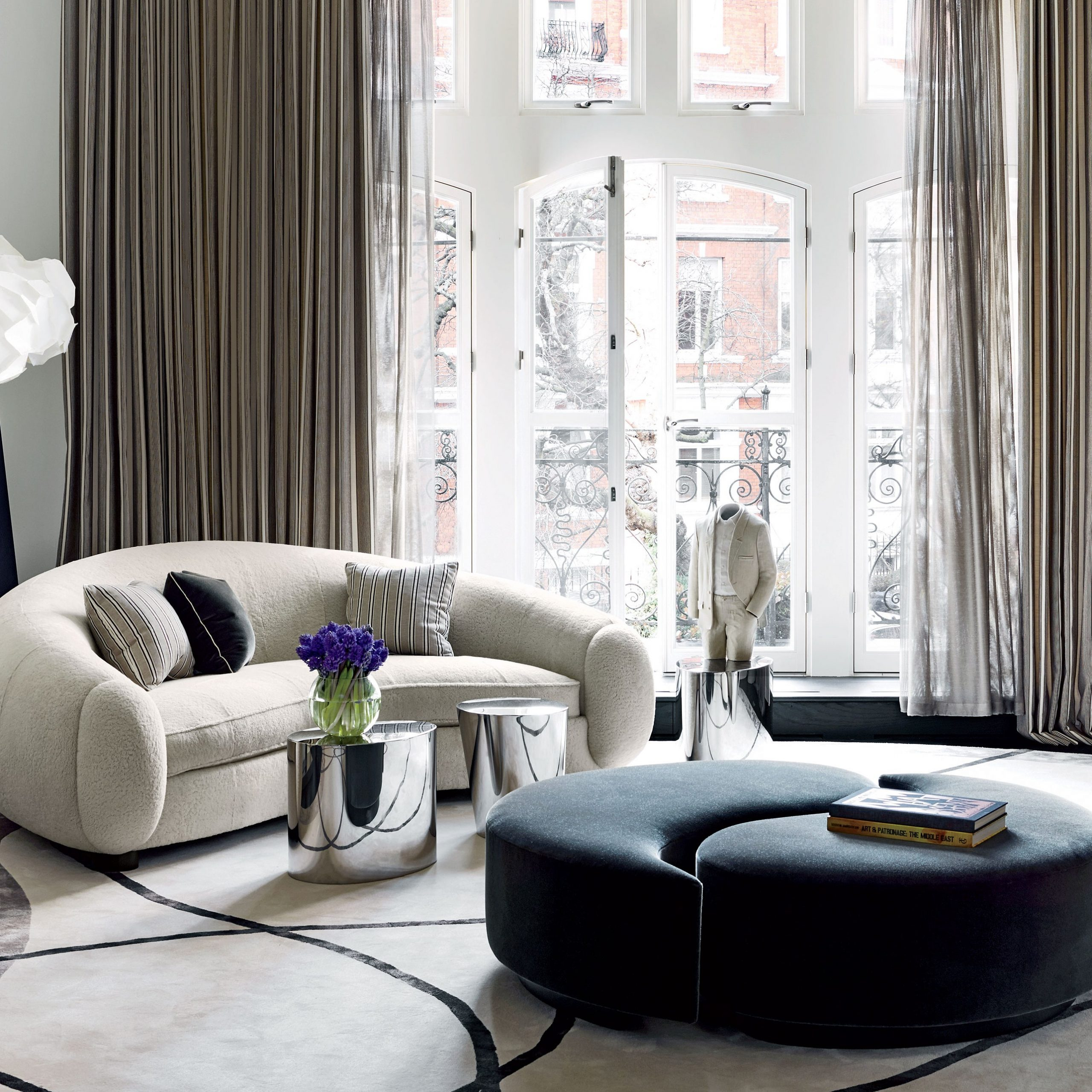 How To Incorporate Ottomans Into Your Living Room Decor With Regard To Starks Tufted Fabric Chesterfield Chair And Ottoman Sets (View 11 of 15)