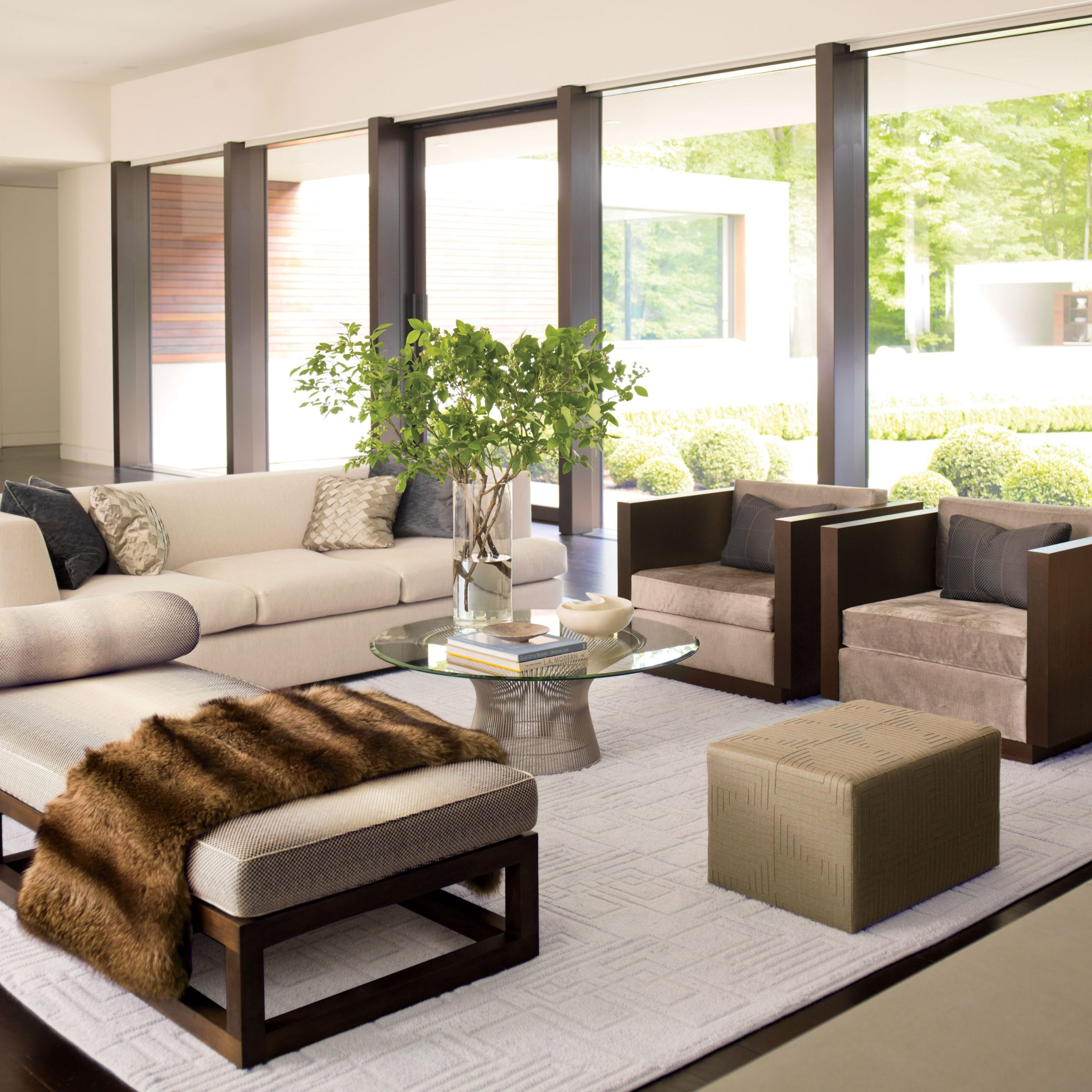 How To Incorporate Ottomans Into Your Living Room Decor Within Starks Tufted Fabric Chesterfield Chair And Ottoman Sets (View 12 of 15)