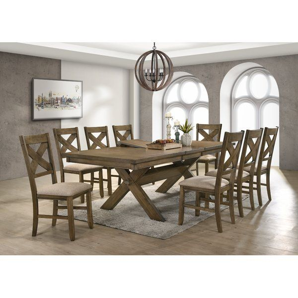 Give Your Dining Area A Warm, Welcoming Update With This 9 Inside 2017 Babbie Butterfly Leaf Pine Solid Wood Trestle Dining Tables (View 14 of 15)