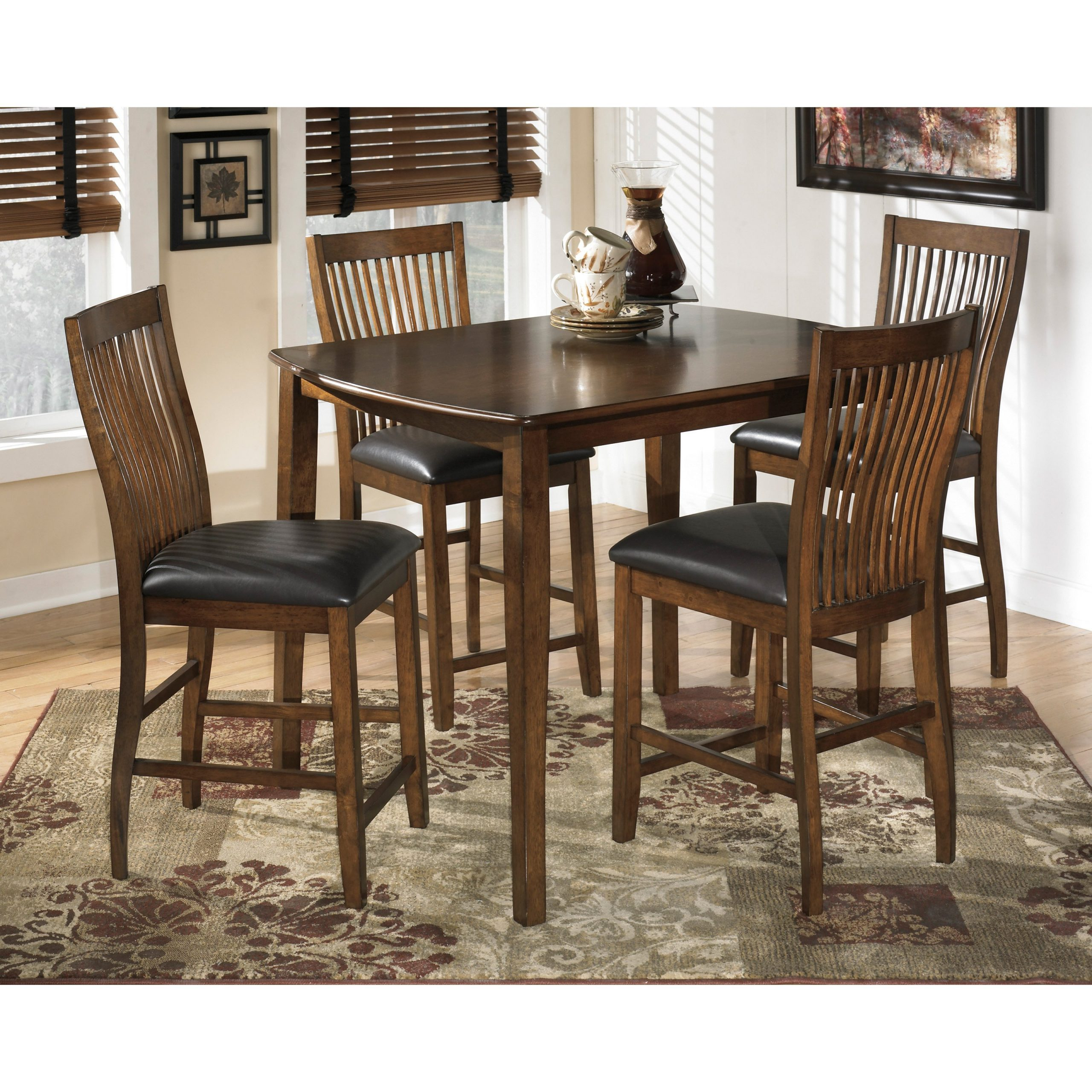 Signature Designashley Stuman 5 Piece Rectangular Pertaining To Most Current Desloge Counter Height Trestle Dining Tables (View 9 of 15)