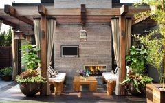 Asian Inspired Outdoor Area With Fireplace