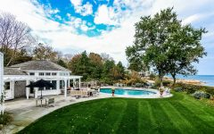Backyard Features Stone Patio and Private Pool