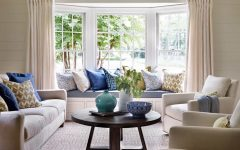 Bright Living Room With Built in Window Seat and Blue Accents