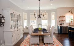 Bright Natural Light Dining Room Featuring White Wood Furniture