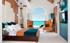 Coastal Bedroom With Arched Window