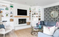 Coastal Living Room With Seashell Wallpaper and Built in Bookcases