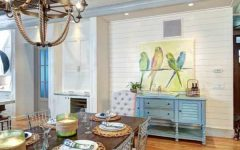 Coastal Style Dining Room With Exposed Beams and Nautical Chandelier