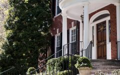 Colonial House Exterior With Classic Terrace and White Pillars