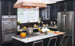 Colonial Kitchen With Copper Range Hood and Black Cabinets