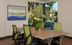 Contemporary Meeting Space With Lime Green Chairs