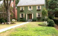 Federal Style Home With Green Paint and Yellow Shutters
